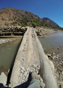During the dry season, this pedestrian bridge is used to cross the deepest flowing section of the river. The community fords the river for vehicles and farms the sections of riverbed where the water has receded.