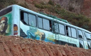 """The Cruise of the Love""—one of the buses that stop on the road across the river from Llapallapani. The buses have different artwork and words along the exterior in hopes of enticing riders to choose their bus."